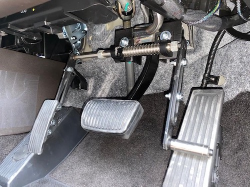 flip up left foot accelerator vehicle modification for disability