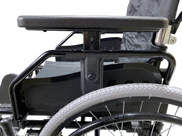 Lightweight manual wheelchair with height adjusted armrests